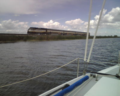 Sailing near Discovery Bay with Amtrak crossing the causeway